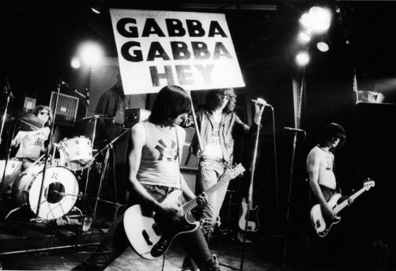 "Ramones, CBGB. ""I love that Joey Ramone is holding up the 'Gabba Gabba Hey' sign himself, before they started bringing Zippy onstage to hold it during 'Pinhead.''(Godlis,1977)"