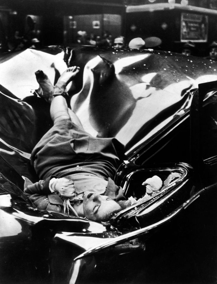 Body of 23-yr-old Evelyn McHale lying atop crumpled limousine minutes after she jumped to her death from the observation platform of the Empire State Building.