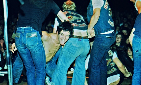 Burnel is dragged back on stage by Hells Angels during a 1977 concert in Bracknell. Photograph: Peter Still/Redferns