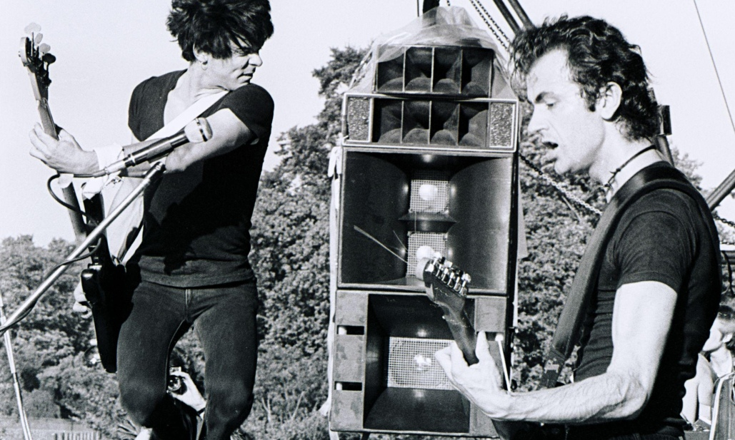 The Stranglers' Jean-Jacques Burnel and Hugh Cornwell playing in Battersea Park in London in 1978