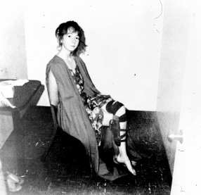 In this never-before-published police photo released September 3, 1976 by the Sacramento Bee, Lynette Fromme is shown in an interrogation room shortly after her capture, with an empty holster still strapped to her leg. On September 5, 1975, Fromme attempted to assassinate President Ford with a gun outside the California Capitol. She was later convicted and sent to federal prison. (AP Photo/Police Handout via Sacramento Bee)