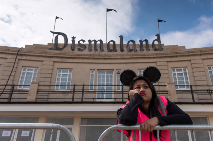 WESTON-SUPER-MARE, ENGLAND - AUGUST 20: A steward is seen outside Bansky's 'Dismaland' exhibition, which opens tomorrow, at a derelict seafront lido on August 20, 2015 in Weston-Super-Mare, England. The show is Banskys first in the UK since the Banksy v Bristol Museum show in 2009 and will be open for 6 weeks at the Topicana site. (Photo by Matthew Horwood/Getty Images)