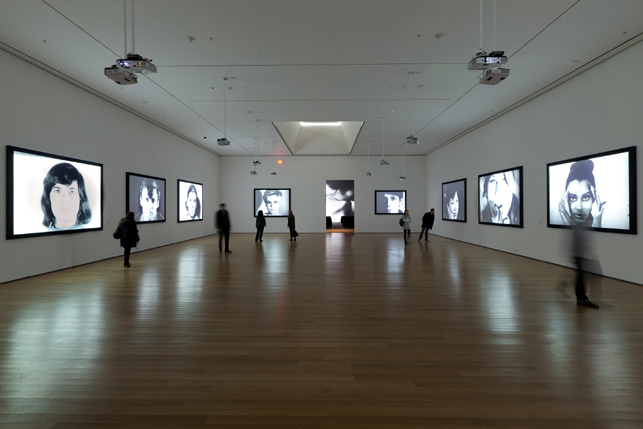 Installation view of Andy Warhol: Motion Pictures at The Museum of Modern Art, 2010. Left to right, Screen Test: Susan Sontag (1964), Screen Test: Dennis Hopper (1964), Screen Test: Kathe Dees (1964), Screen Test: Edie Sedgwick (1965), Kiss (1963–64), Screen Test: Lou Reed (1966), Screen Test: Kyoko Kishida (1964), Screen Test: Baby Jane Holzer (1964), and Screen Test: Donyale Luna (1964). © 2010 The Andy Warhol Museum, Pittsburgh, PA, a museum of Carnegie Institute. All rights reserved. Photo: Jason Mandella