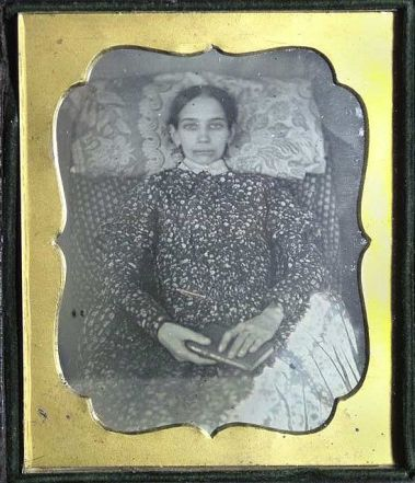 Example of a postmortem photo where eyes have been painted onto the girls eyelids so it appears her eyes are open and that she is alert.
