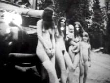 Early Manson Family 1968 driving in the infamous black bus. It's the only pic I was able to find of it.