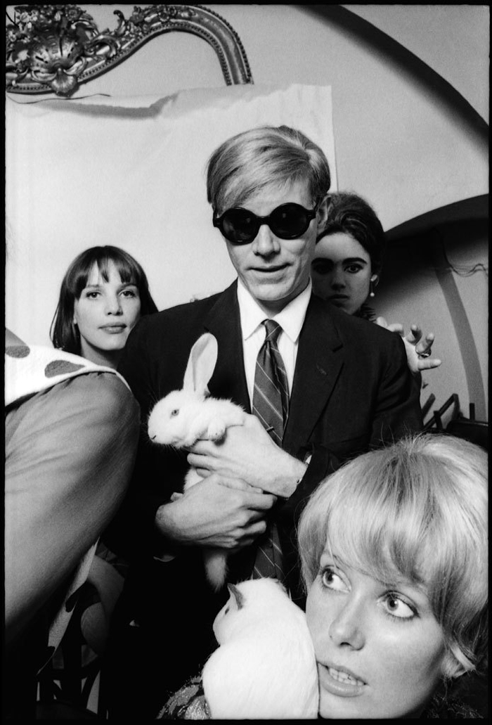 Andy pulling out a rabbit for Catherine Deneuve, Edie Sedgwick, and Zouzou 1966 by Jean-Jacques Bugat
