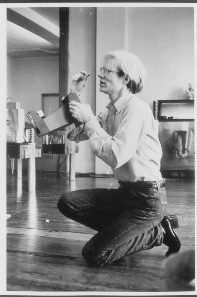 Andy working on as portrait, second Factory 33 Union Square West, 1973 by Victor Bockris