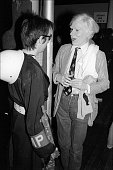 American author Victor Bockris, dressed as an MP, talks with Pop artist Andy Warhol at the Mudd Club's 'Combat Love' event, New York, New York, June 17, 1979. (Photo by Allan Tannenbaum/Getty Images)