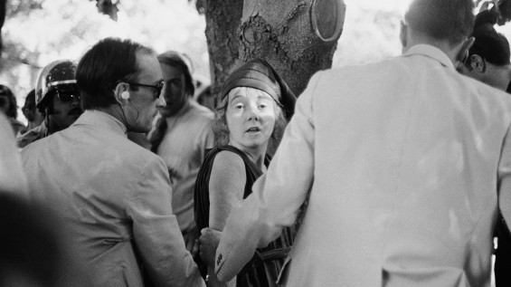 """Secret Service agents lead Lynette """"Squeaky"""" Fromme away after she pointed a gun at President Gerald Ford in Sacramento in 1975. (Associated Press)"""