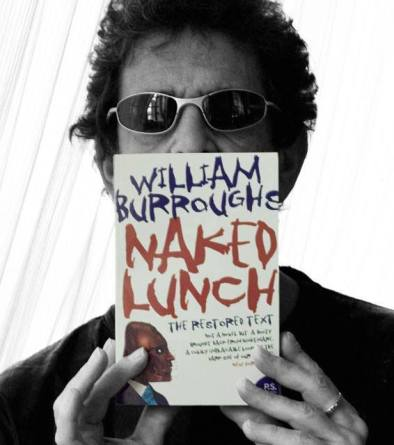 Lou proudly exhibiting Burroughs' Naked Lunch